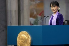 Myanmar opposition leader Aung San Suu Kyi delivers her Nobel acceptance speech during a ceremony at Oslo's City Hall June 16, 2012. Aung San finally accepted her 1991 Nobel Peace Prize in Oslo on Saturday after spending a total of 15 years under house arrest and said full political freedom in her country was still a long way off. REUTERS/Daniel Sannum Lauten/Pool