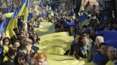 March 30, 2014People hold long lengths of cloth in the colours of the Ukrainian national flag as they take part in a rally against the annexation of the Black Sea peninsula of Crimea by Russia, in Odessa March 30, 2014. Russia said on Saturday it had no intention of invading eastern Ukraine following its annexation of Crimea, while the Black Sea peninsula's Muslim Tatars demanded autonomy. REUTERS/Yevgeny Volokin